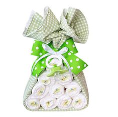 Stork Bundle--not a baby cake hahaha diapers wrapped in a blanket (or swaddle cloth) tied with a bow (or a burp cloth) decorated with  a passy.   Love this idea  from Tori