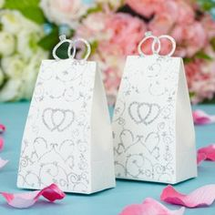 Wedding Favors - $3.39 - Double Heart Handbag shaped Favor Boxes (Set of 12)  http://www.dressfirst.com/Double-Heart-Handbag-Shaped-Favor-Boxes-Set-Of-12-050038232-g38232