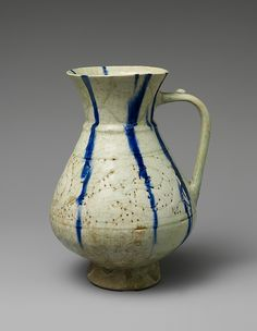 White Ewer with Blue Streaks Object Name: Ewer Date: 12th–13th century Geography: Iran, Kashan Culture: Islamic Medium: Stonepaste; molded, carved and pierced, painted under transparent glaze Dimensions: 8 1/4 in. (21 cm) Classification: Ceramics Credit Line: H. O. Havemeyer Collection, Gift of Horace Havemeyer, 1929 Accession Number: 29.160.1