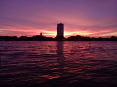 Sunset on the riverbank of the Chao Phraya in Bangkok.
