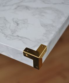 Love how these decorative brass corners look on this faux marble fireplace hearth at The Painted Hive!