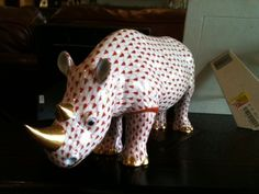 Herend Hand Painted Porcelain Figurine of Rhino, Looks Like Red Fishnet, Gold Accents.