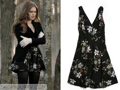 Lydia Martin (Holland Roden) wears thisblack floral dress in Teen Wolf Season 1 Episode 10: 'Co-Captain'. It is from American Rag. It is no longer available. Originally posted atteenwolfclothes.