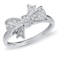 1/10 CT. T.W. Diamond Bow Ring in 10K White Gold from Zales, $270.  This is the prettiest bow ring I've seen yet.  I tried to find a replica that looked something like it, but can't.