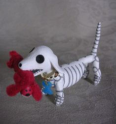 Day of the Dead Dachshund Weenie Dog Skeleton by Claylindo on Etsy, $30.00 (if only it looked like Marley!!)