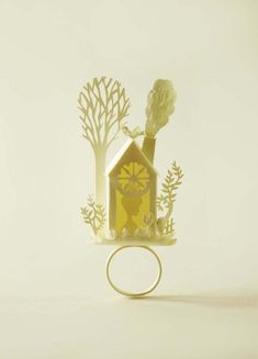 paper cutting art....a liitle paper sculpture on a ring. So tiny! Delicate! Beautiful! Pinned just for @Kris
