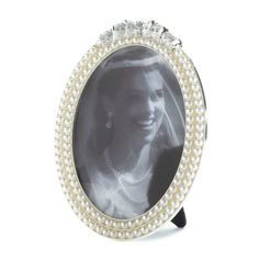 Classic pearl strands are the perfect showcase for your special memories. This oval photo frame fits a 5x7 photo and features two rows of faux pearls topped with glittering stones along with an easel stand for tabletop display. Strands Of Pearl Photo Frame 5x7 by Rustica House. #myRustica
