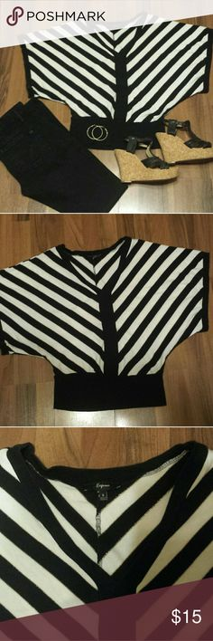 Express Bat-Wing Style Top This top has a deep v-neck & is cool and graphic with its black and white diagonal stripes that are edged in shimmering gold thread. This is an oversized Small so it fits like a Medium. Throw on over a black camisole and pair with jeans. Express Tops
