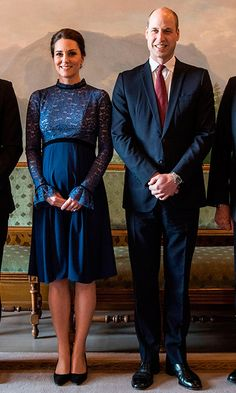As the Duke and Duchess made their way indoors, Kate revealed her sweet mom-to-be look: a lace bodice long-sleeved 'Marlene' dress by royal maternity favorite Seraphine.