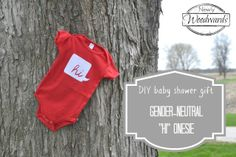 Make a simple gender-neutral onesie with heat transfer material and a red onesie. Perfect DIY baby shower gift.