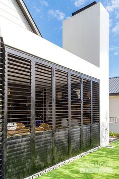 Control light and ventilation of your patio with shutters. Balcony Grill Design, Backyard Patio Designs, Door Gate Design, Window Design, American Shutters, Outdoor Shutters, Security Shutters, Patio Railing, Patio Enclosures