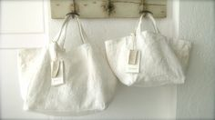 by Ana & Cuca.Ana & Cuca's mission~ recycle, invent, transform, rescueThese linen totes are of infinite quality, many of them in the second h. Sacs Tote Bags, Reusable Tote Bags, White Tote Bag, White Bags, White White, Anita, Linen Bag, Fabric Bags, Market Bag