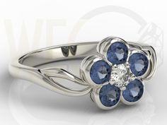 Pierścionek w formie kwiatu z białego złota z szafirami i diamentami /  Flower-shaped ring made from white gold with diamonds and sapphires / 2329 PLN #jewellery #jewelry #gold #ring #flower #diamonds #sapphires