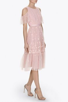 The Daisy Embroidery Dress has a flattering silhouette with a fitted bodice. It features an open back and shoulder detail, with subtly fluted sleeve frills. Our signature grosgrain trim waistband finishes the waist. Created in delicate tulle fabric with cotton thread embroidery, the dress adds a new handwriting to our Pre Spring 17 collection. The densely embroidered artwork gives a soft three dimensional effect, creating more definition in the intricate motifs, which are inspired by meadows…