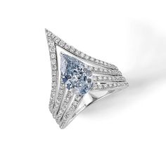 Messika blue diamond ring from the Queen V collection.