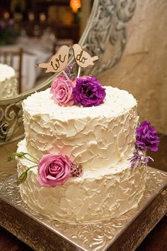 Beautiful wedding cake with simple flowers and cute wooden cake topper!!! adorable