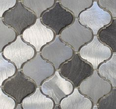 A balanced blend of warmth and coolness make this tile an easy choice for the home. These are a smaller arabesque tile than our glass tiles. Each tile is made from brushed aluminum. They are roughly 2 Kitchen Redo, Kitchen Backsplash, Backsplash Ideas, Tile Ideas, Kitchen Remodel, Backsplash Panels, Kitchen White, Kitchen Cabinets, Fantasy Brown