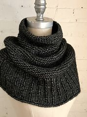 Simple and stylish, GETTING WARMER is a light and cozy cowl worked from the bottom up, transitioning from easy 2×2 rib to garter stitch in the round with regular decreases. It can be pulled down over one or both shoulders and the neck will remain snug and close without gaping. Knit with three skeins of Woolfolk LUFT, a luscious and ultra-soft blend of merino and cotton.