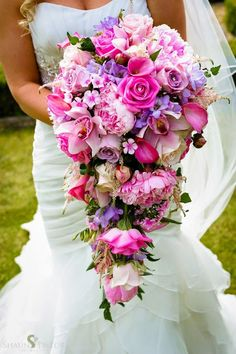 pink wedding bouquet via Shaun Taylor Photography / http://www.deerpearlflowers.com/cascading-wedding-bouquets/