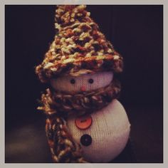 Sock snowman with crochet hat and scarf