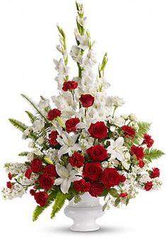 This will be the shape and size of the arrangements for Bianca's aisle pedestals. The flowers will, of course, be red roses and white calla lilies. I will also have some greenery added such as fern and eucalyptus leaves to create some interest in the arrangement.