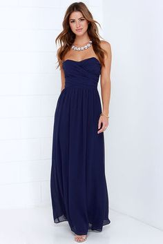 LuLu*s Exclusive! Be the center of attention and the queen of the scene in the Royal Engagement Strapless Navy Blue Maxi Dress! This soft chiffon maxi dress has elegant panels crisscrossing over a sweetheart bodice (with lightly padded cups), creating a gorgeous pairing with the long flowing maxi skirt that drapes from gathering at the waist. Hidden back zipper. Fully lined. 100% Polyester. Hand Wash Cold or Dry Clean. Made with Love in the U.S.A.