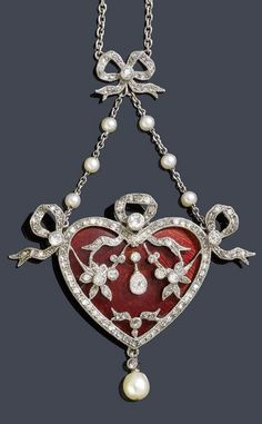 A BELLE EPOQUE ENAMEL, PEARL AND DIAMOND NECKLACE, CIRCA 1910. Charming heart-shaped enamelled pendant with openwork flower and bow motifs set with diamonds, suspending a pearl drop, mounted in platinum and gold, length 3.9cm. #BelleÉpoque #pendant