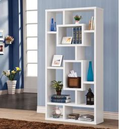 This sophisticated style bookcase is done in white and brings an unique atmosphere to any home office.