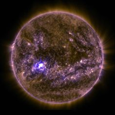 NASA's Solar Dynamics Observatory captured an image of an X2.2 solar flare on March 11, 2015, seen as a bright flash of light on the left side of the sun. Earth is shown for scale.<br />