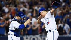 """image: <span style=""""font-size:13px;"""">Toronto Blue Jays closer Roberto Osuna and catcher Russell Martin.</span>"""