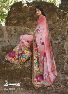 Lightsalmon & off white color georgette saree with having beautiful floral prints & elegant lace.