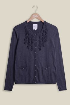 The beauty is in the detail on our Ruffle Cardi. The lovely super-soft cardigan stands out from others as it shows off voile ruffles on the front. It can be fastened with our mother of pearl buttons, and perfectly practical with two small front pockets.