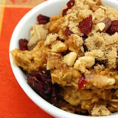 Hearty oatmeal spiced with cinnamon, cloves, and pureed pumpkin, topped with walnuts, cranberries and a sprinkling of brown sugar.