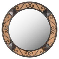 "Circular wall mirror with a birch frame.  Product: Wall mirrorConstruction Material: Birch and mirrored glassColor: Dark brownDimensions: 42.5"" Diameter x 0.98"" D"