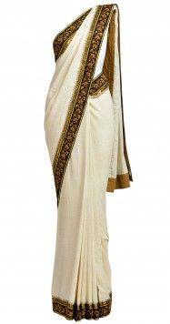 Ivory khadi sari with zardosi border by SABYASACHI.   Price -  Rs. 29,500