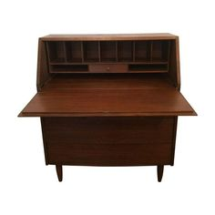 Restored Mid-Century Modern Secretary - Need a refreshed work space? This restored secretary is sure to inspire you! Plenty of compartments for organizing your tools of the trade, as well as three drawers below the desk for additional storage.