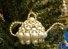 """This 3"""" x 1 ½"""" beaded ornament is so reminiscent of the little teapot that is short and stout and you can see the handle, and the spout! It is made from first quality Japanese pearls and is perfect for giving as a hospitality gift when you visit other's homes over the holidays.  The ornament is carefully packed in a gift box and includes a card attached describing the Christian symbolism, as follows:  """"Showing sincere friendliness, generosity and consideration for all that enter our home is…"""