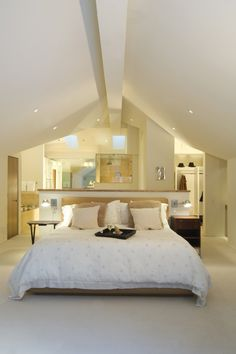 60 Attic Bedroom Ideas (Many Designs with Skylights) An open concept attic space houses a bedroom, closet, and bathroom. The bed is situated against a half-wall, creating a separate-yet-together feeling to this attic apartment. Modern Bedroom, Loft Conversion Bedroom, Attic Apartment, Attic Master Suite, Attic Master Bedroom, Closet Bedroom, Bedroom Design, Loft Room, Budget Bedroom
