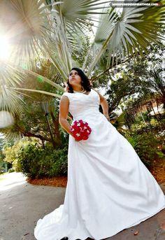 Our #DisneyWedding at the #PolynesianResort at #Disney.   #DisneyWedding #weddingcake #roses #Stephanotis #hiddenmickey #love #marriage #weddingdress #pearls #weddingpearls