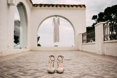 Metallic Silver Steve Madden Shoes | Embellished Ze García Bridal Gown with Front Split | Stylish Outdoor Wedding at Masia Casa del Mar in Barcelona, Spain | Sara Lobla Photography | Made in Video Film