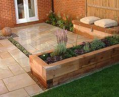 Mark Langford Garden Design. Sandstone sphere, thyme dry rill, built in storage bench, raised sleeper beds, sawn sandstone paving. #raisedbedsstorage