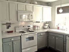 Love the idea of white on white appliances and gray lower cabinets