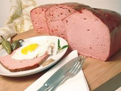 Leberkäse (German, literally means 'liver cheese'; sometimes spelled Leberkäs or Leberka(a)s) - find the recipe to make it at home @ www. in English Read Recipe by Bavarian Recipes, Austrian Recipes, German Recipes, Charcuterie, Sausage Recipes, Cooking Recipes, German Meat, Fried Bologna, Polish Recipes