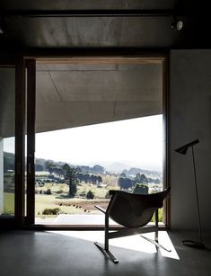 """Richly Furnished Home Frames Striking Landscape Views - Photo 7 of 10 - A Clement Meadmore Sling chair provides a favorite vantage point for sipping coffee while looking out at Hanging Rock. """"It's always hard to leave and return to the city,"""" Titania says."""