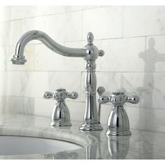 This Victorian-style widespread faucet is constructed of a solid brass body for enhanced finish and performance. Simple installation makes for an easy upgrade in any bathroom. Its 2-handle design and quarter-turn handle stops make it easy to use in a striking, classic design.