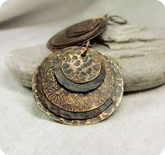 Earrings   Iena Suhomlin.  Copper; embossed, etched and black patina.