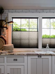 """For the ultimate in flexibility, consider shades that can be raised and lowered from the top or bottom as needed. """"These simple and sleek shades by Kirsch can drop down from the top or raised up from the bottom to allow you to control the view or the sunlight as needed,"""" says the retailer. 10 Stylish Kitchen Window Treatment Ideas 