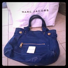 Marc Jacobs Royal Blue with Gold Hardware Purse Gorgeous Royal Blue Marc Jacobs Handbag. This is an authentic MJ satchel handbag that can be worn over the shoulder or on the arm. This bag is large enough to be used for work and school and I showed in the last picture that it fits a laptop perfectly. This bag is definitely pre-loved with some discolor we marks on the bottom of the purse (hard to see unless examining closely- hence the lower price). Dustbag is included. Please feel free to…