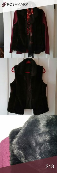 Fuzzy black vest Fashionable but warm for the winter! Zip front, fuzzy black vest. I must have cut the tag off because it was itchy so no clue what brand is...I would definitely say this is a medium. It is in great shape! Jackets & Coats Vests