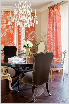 Coral chinoiserie panels and glam chandelier.